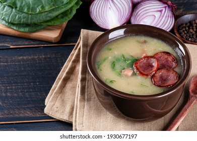 Popular dish of Portuguese cuisine called Caldo Verde. Made with potatoes, bacon, pepperoni sausage and kale. Copy space