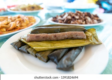 Popular Filipino dessert - Suman is a Philippine favorite made of sticky rice in banana and cooked in coconut milk
