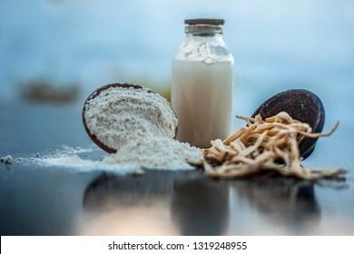 Popular Indian & Asian ayurvedic organic herb musli Safed Moosli/ Shaqaqule/ Dholi Musli/ Khiruva/ Shedheveli/ Swetha Musli/ Taniravi Thang/ in a clay bowl along with raw milk and its powder also.