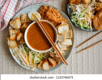 Popular Indian cuisine in Malaysia / Rojak or Pasembur / Fried dough shrimp fritters, tofu, egg, spicy cuttlefish, shredded cucumber, turnip and bean sprouts in thick and spicy peanut gravy sauce