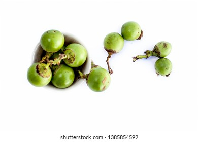 Popular Indian pickle fruit isolated on white i.e. Fragrant manjack or snotty gobbles, glue berry, pink pearl, bird lime tree, Indian cherry, Lasoda Tenti,Dela or gunda.