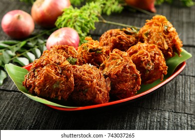 Popular Indian street food-Healthy and delicious spicy snack spicy onion fritters.