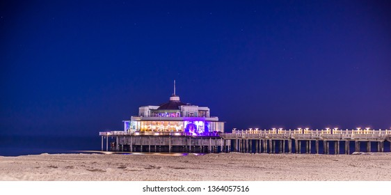 The popular jetty of Blankenberge lighted by night, Architecture of the Belgian coast in Belgium