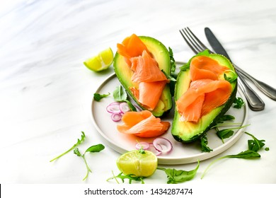 Popular keto diet : salmon and avocado  with arugula and lime. healthy lunch. ketogenic diet  food