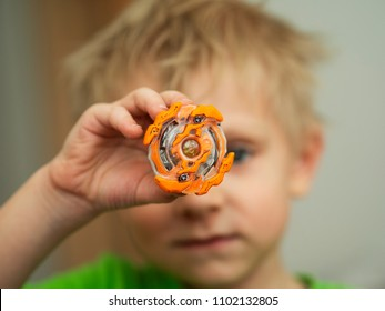 Popular kids toys. Little caucasian boy demonstrated Beyblade
