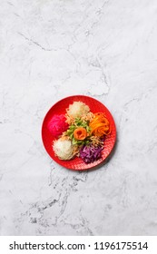 """Popular in Malaysia and Singapore region Chinese new year raw salmon fish salad dish """"Yu Sheng"""" on marble top. Text space image."""