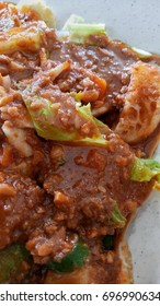 Popular Malaysian salad Rojak Pasembur consisting of shredded cucumber, potatoes, beancurd, turnip, chili, bean sprouts and mix seafoods with a sweet and spicy nut sauce.
