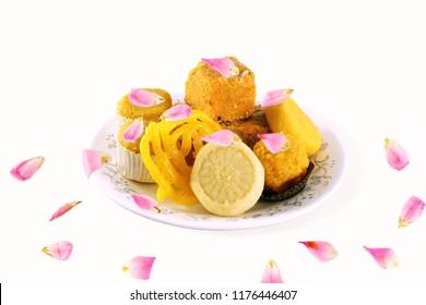 Popular mix traditional Indian gujarati mithai or sweet with rose petal garnish