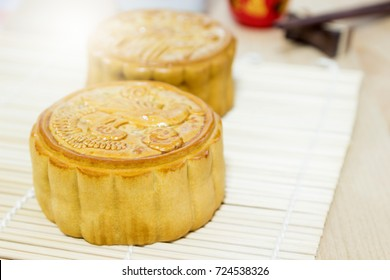 The popular Mooncake festival is celebrated by Chinese all over the world served with hot Chinese tea drink on the table