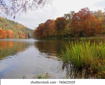 Popular Mountain Forks River at the Beavers Bend State Parks in Broken Bow, Oklahoma with colorful foliage in autumn
