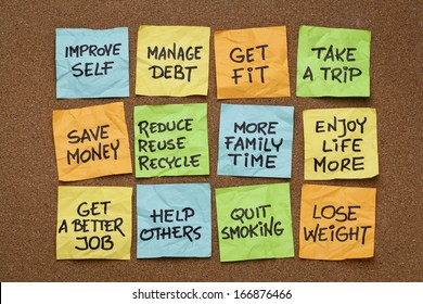 popular new year resolutions - colorful sticky notes on a cork board