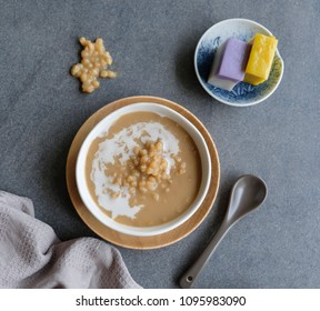 Popular Nyonya dessert / Wheat Porridge with Coconut Milk & Nyonya kueh / Sweetened with palm sugar and fragrance leaf, a delicacy among Malaysian and Singaporean