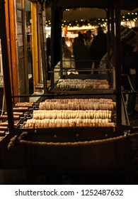Popular product of bakeries - trdelnik. Christmas market on Old Town Square, Prague, Czech Republic.