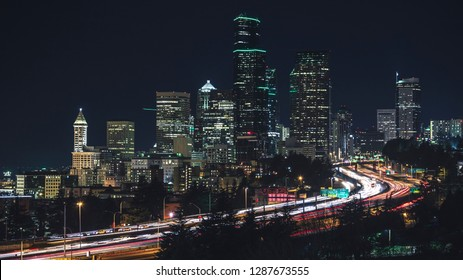 Popular Seattle Skyline View at Night with Business Office Buildings and Car Streaks