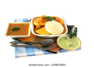 Popular South indian breakfast food Idly sambar or Idli rice and lentils steamed cakes with spicy soup Sambhar and green coconut chutney