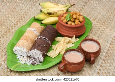 Popular South Indian breakfast puttu / pittu made of ragi / finger millet flour and coconut  in the bamboo mould / utensil, Kerala, India. Bamboo puttu. Sri lankan food