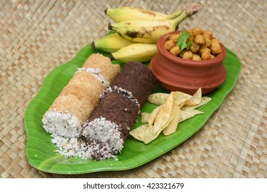 Popular South Indian breakfast puttu / pittu made of ragi / finger millet flour and coconut  in the bamboo mould / utensil, Kerala, India. Bamboo puttu.