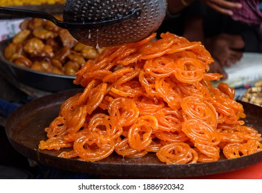 Popular sweet snack of South and Western Asia, named  Jalebi, also known as Jilapi, zulbia, mushabak and zalabia, displayed for Sale. Selective Focus is used.
