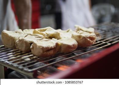 popular toasted bun in thai chinatown Yaowarat bangkok thailand