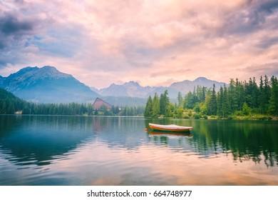 Popular tourist destination in High Tatra mountains, lake Strbske pleso, amazing colors landscape, pink sunset after storm, Slovakia (Slovensko)