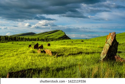 "Popular tourist destination in Russia, Khakassia, ""Chests"", old burial ground, big stones, hills"