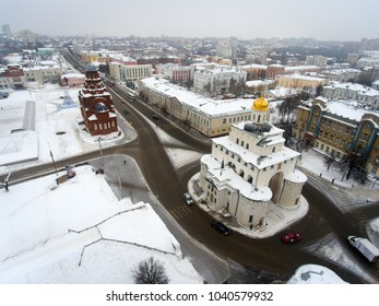 """Popular tourist route """"Golden Ring of Russia"""". Golden Gate, Trinity Church on a winter day from the air. Vladimir. Russia."""