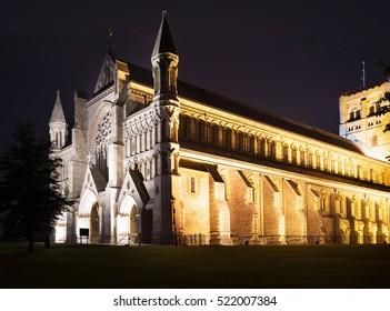 Popular tourist St Albans abbey church in night lights illumination in London, England, United Kingdom
