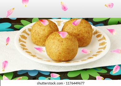 Popular traditional Indian gujarati mithai or sweet laddu ladu bundi with rose petal garnish