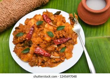 Popular traditional South Indian food  Kappa or tapioca biryani hot and spicy dish made with cooked organic cassava root, grated coconut, beef or steak and Palm wine Kerala, India. staple food Brazil.