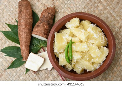 Popular traditional South Indian food cooked tapioca / cassava root / mandioca / aipim with grated coconut in earthen ware Kerala, India. root vegetable Brazil. served with Fish curry, chutney