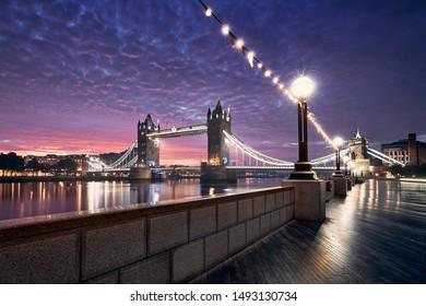 Popular travel destination - Tower Bridge against colorful sunrise. Cityscape of London, United Kingdom
