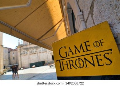 Popular Tv series game of thrones clip board inviting tourists for the tour around filming locations in Dubrovnik. Two tourists is looking at the map in the background.Dubrovnik.Croatia. 2018.08.15