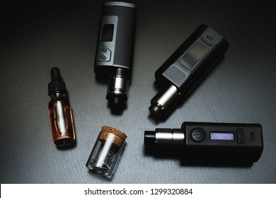 Popular vaping  devices .electronic cigarette over a black background