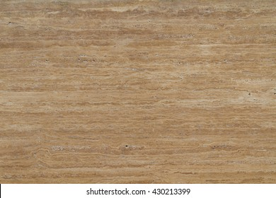 A popular variety of travertine Travertine Classic warm beige color with a pronounced banding and heterogeneity of pattern. Banded texture resembling travertine a woody drawing.