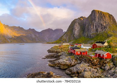 Popular view point of lofoten in Norway with the rainbow in the sky