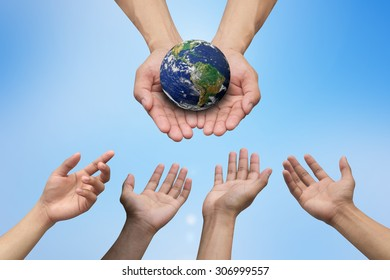 population hands reaching the world for heal together, save the world concept ,Elements of this image furnished by NASA.
