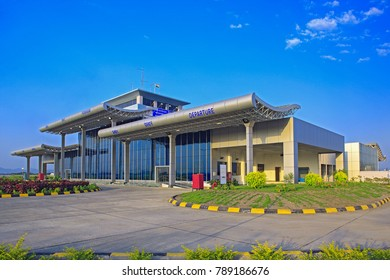Porbandar,  Gujarat ,October, 13,2008 :Exterior view of airport terminal building showing pillars supporting corrugated   metal roofing ,glass panels and garden , Porbandar,Gujarat, India,Asia