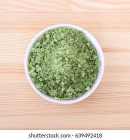 Porcelain bowl with green herbal salt of wild garlic