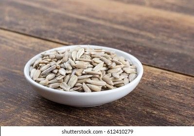 Porcelain bowl with peeled sunflower seeds