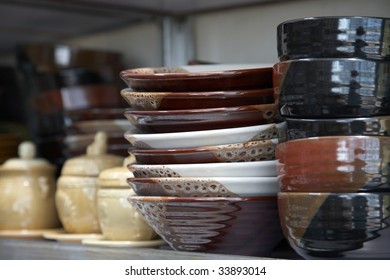 Porcelain bowl and plate on shelf of market.
