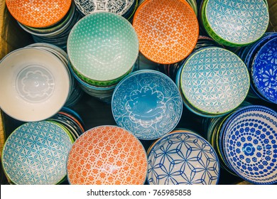 Porcelain Bowl Top View Painted Colorful Modern Pattern Graphics Displayed for Sale as Tableware Background or Backdrop. Minimalist Design with Simple Geometric Forms and Lines in Japanese Asian Style