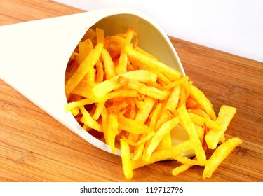 Porcelain cone of chips on wood table.