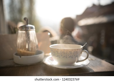 Porcelain cup on wooden table