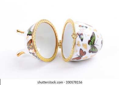a porcelain faberge style decorated egg isolated over a white background