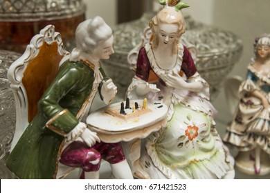 Porcelain figurine, antique vintage ceramic collectible decor, couple playing chess
