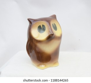 Porcelain owl figurine isolated - kind of a piggy bank