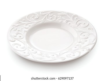 Porcelain plate with floral pattern close-up isolated on white background
