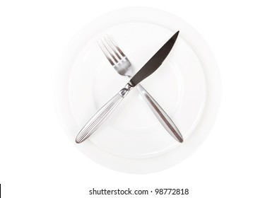 porcelain plate with fork and knife isolated on white