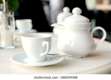 porcelain teapot with cup