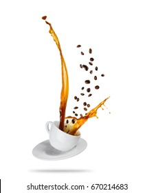 Porcelain white cup with splashing coffee liquid with coffee beans, isolated on white background. Very high resolution image